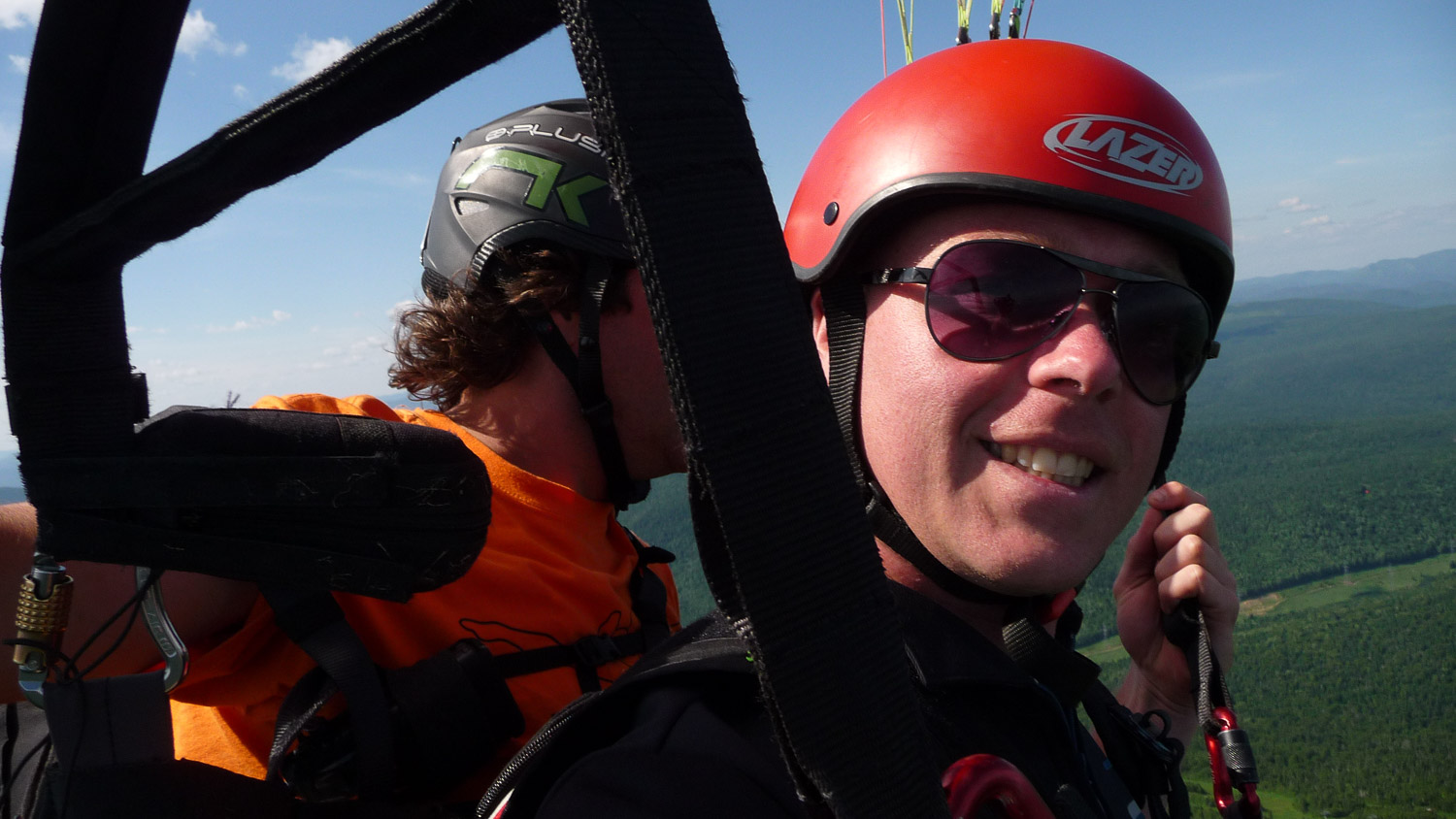 Charles-Emmanuel Brossard paragliding during the filming of Les grands Sentiers on top of Mont Saint-Anne in the Quebec City area